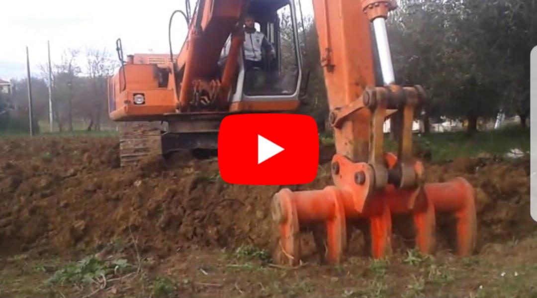 excavator deep ploughing